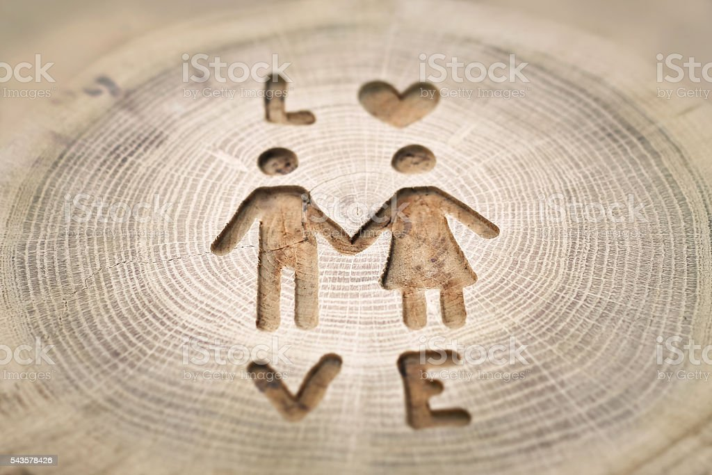 Woodcarving, men and women love. hold hands. Photos stock photo