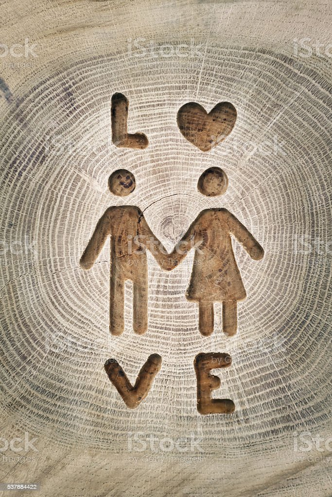 Woodcarving, men and women love. Photos for your design stock photo