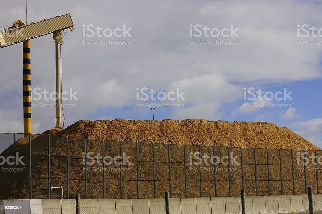 Woodchip pile in port royalty-free stock photo