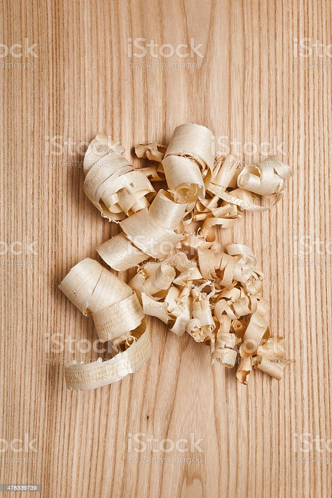 Woodchips (shavings) on wooden surface stock photo