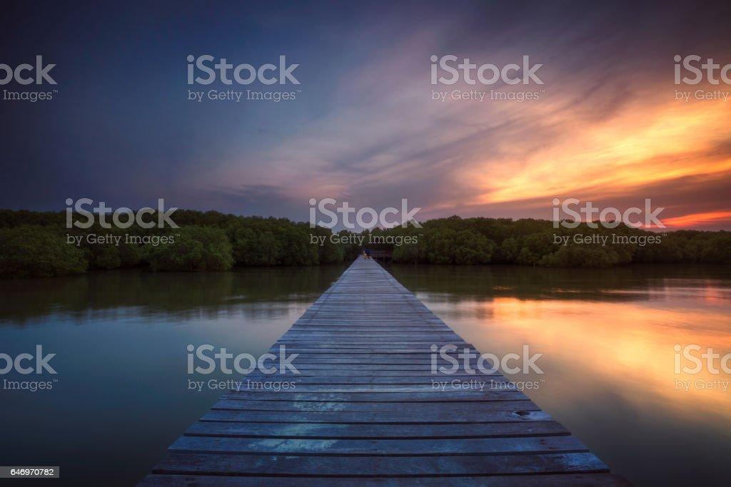 Woodden bridge at sunset in Laem Phak Bia stock photo