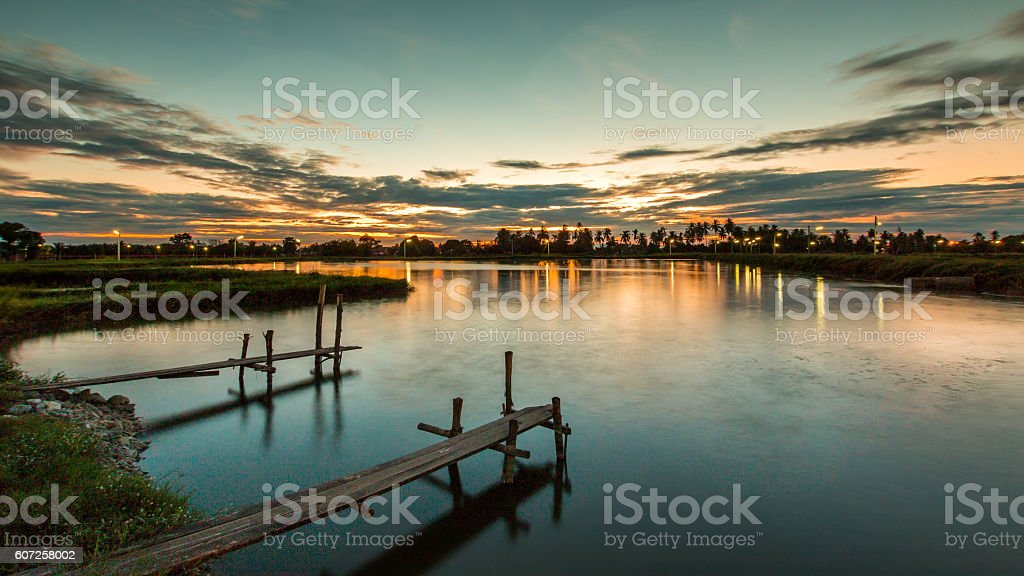Wooded bridge in the port at sunset. stock photo