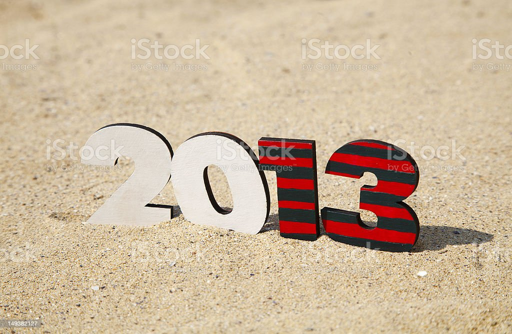 Wooden 2013 year number on the sand royalty-free stock photo