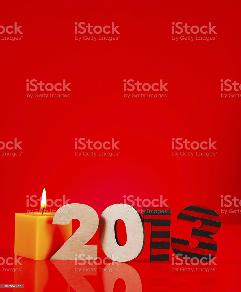 Wooden 2013 year number with a burning candle royalty-free stock photo