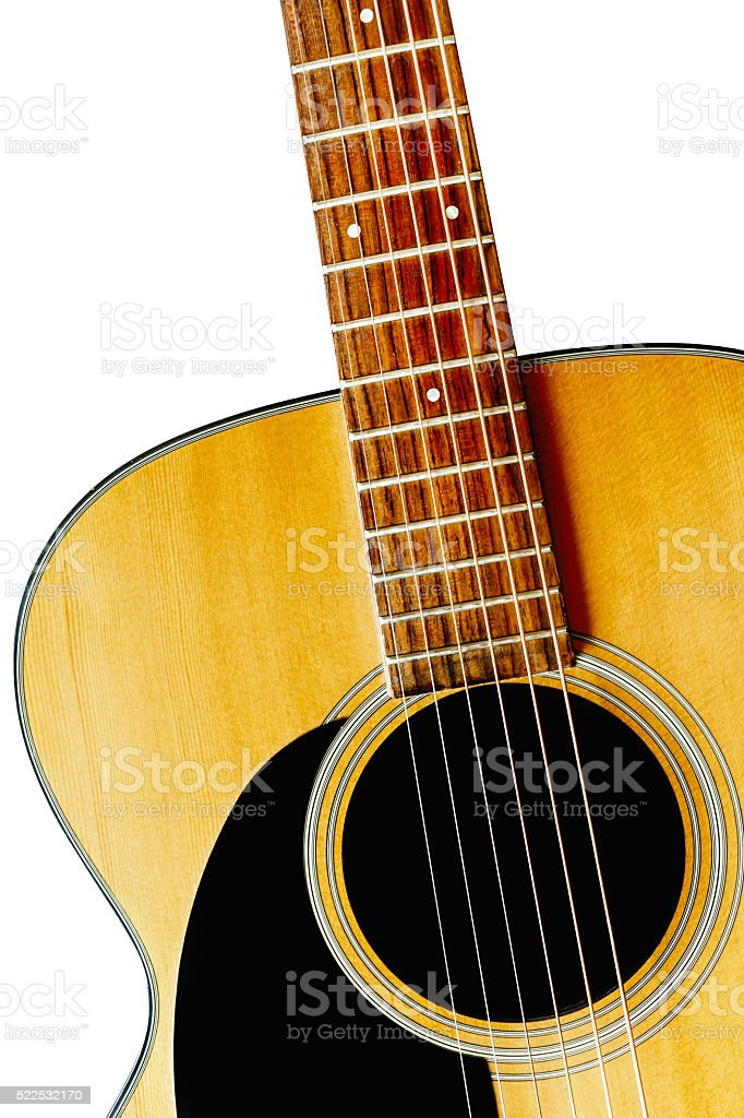 Wooden acoustic guitar isolated closeup stock photo