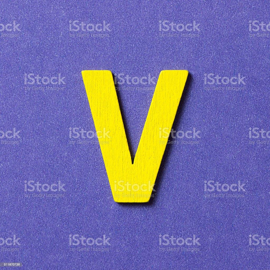 Wooden alphabet V in capital letter stock photo