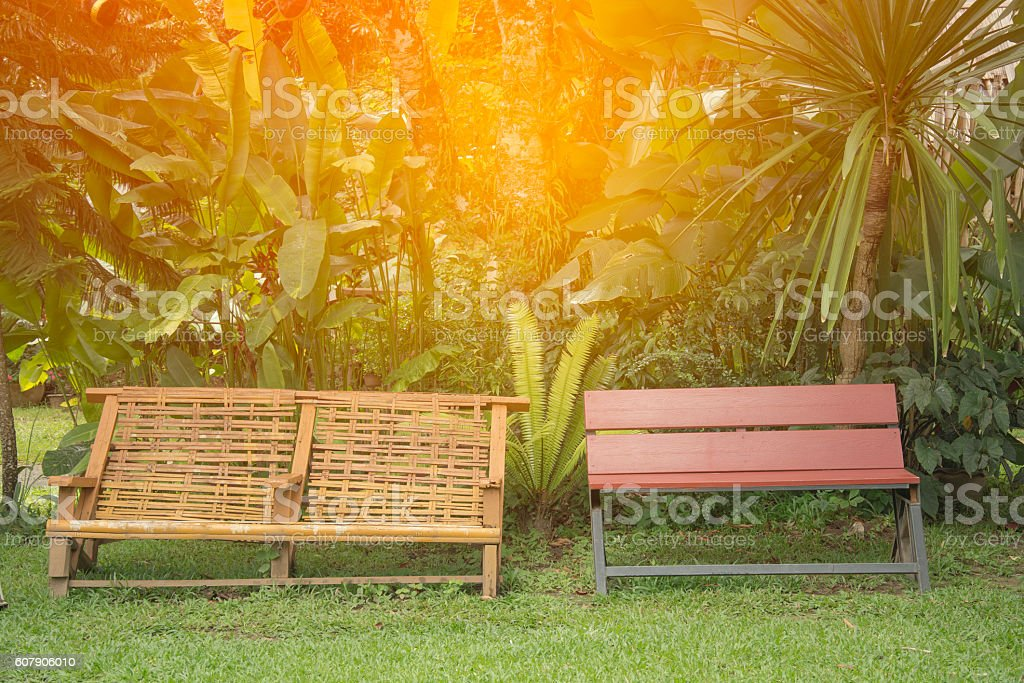 Wooden and Bamboo Park Bench at garden royalty-free stock photo