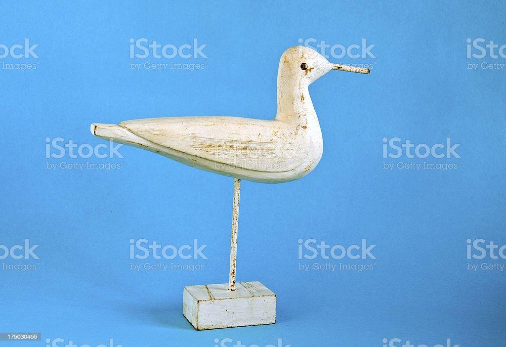 wooden and retro decorative bird sculpture stock photo