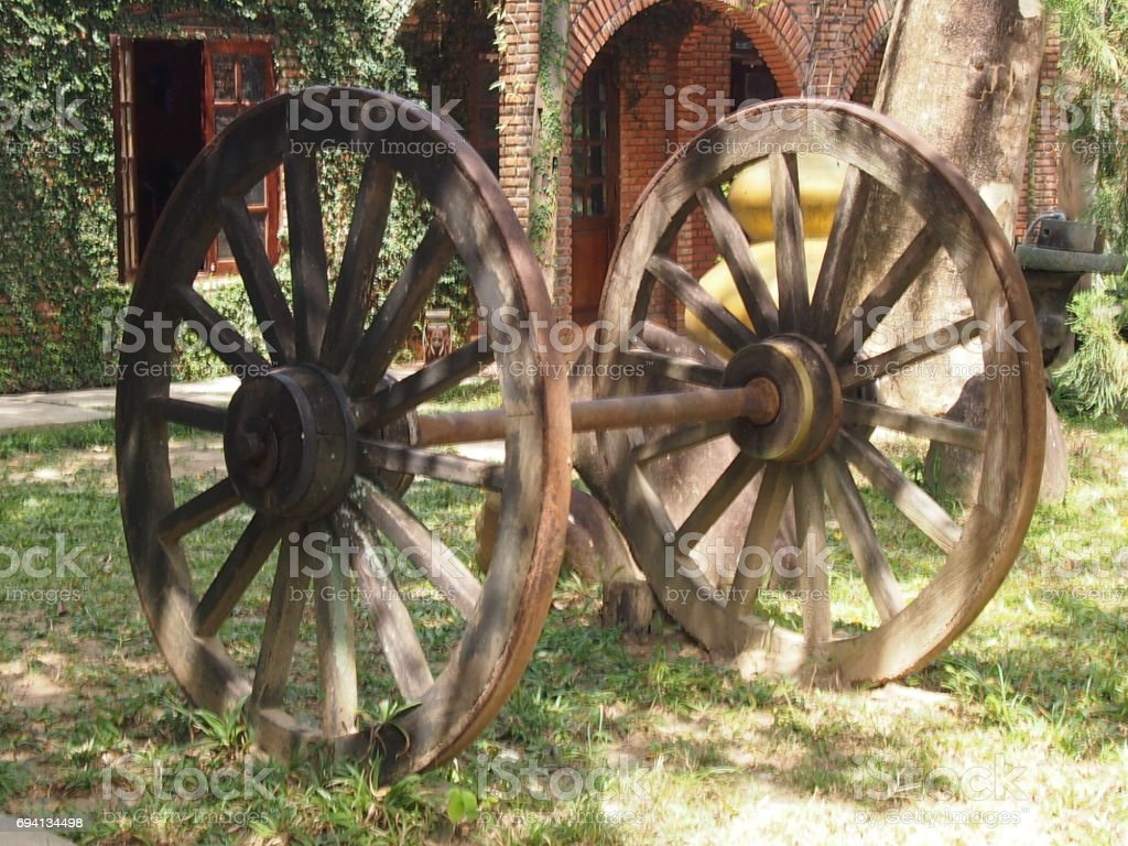 Wooden animal-drawn vehicle wheels stock photo