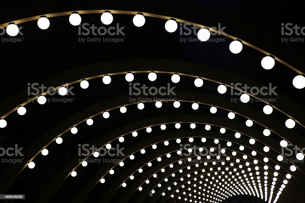 wooden arches with spherical shining lamps stock photo