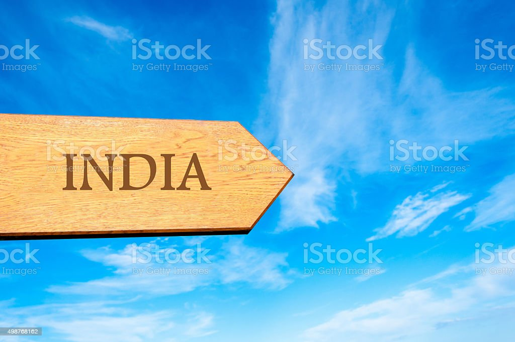 Wooden arrow sign pointing destination INDIA stock photo