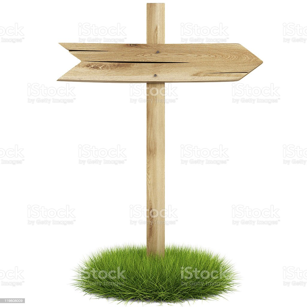 Wooden arrow sign post on a small patch of grass royalty-free stock photo