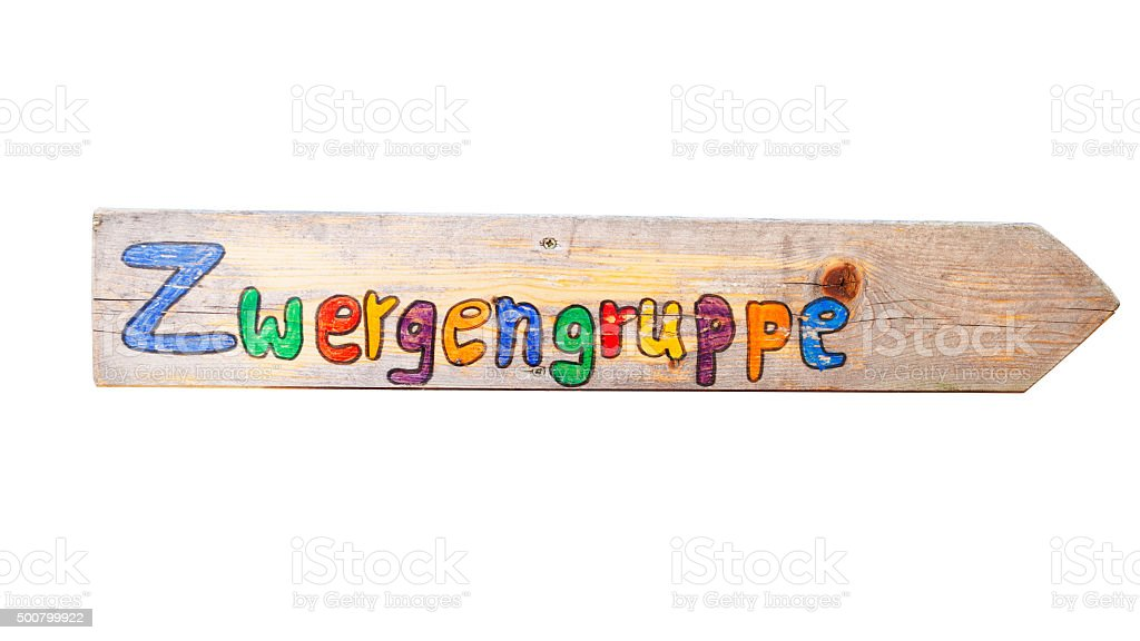 Wooden arrow with text group of dwarfs stock photo