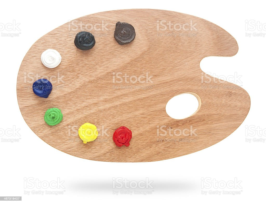 wooden art palette with paint isolated on white stock photo