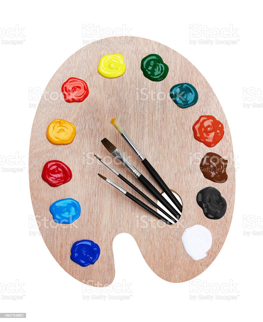 Wooden art palette with paints and brushes stock photo
