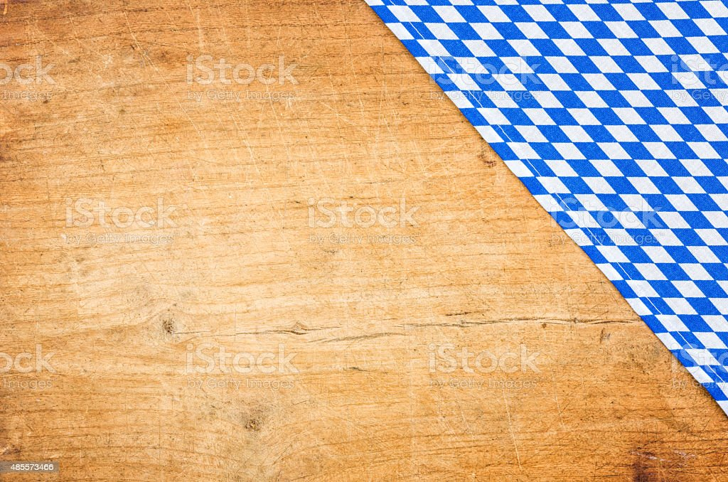 Wooden background with a bavarian table cloth stock photo