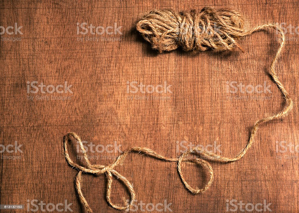 wooden background with a skein of twine stock photo