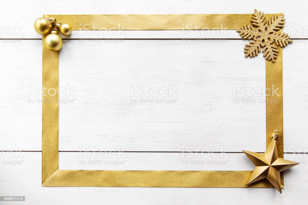 Wooden background with gold bow stock photo