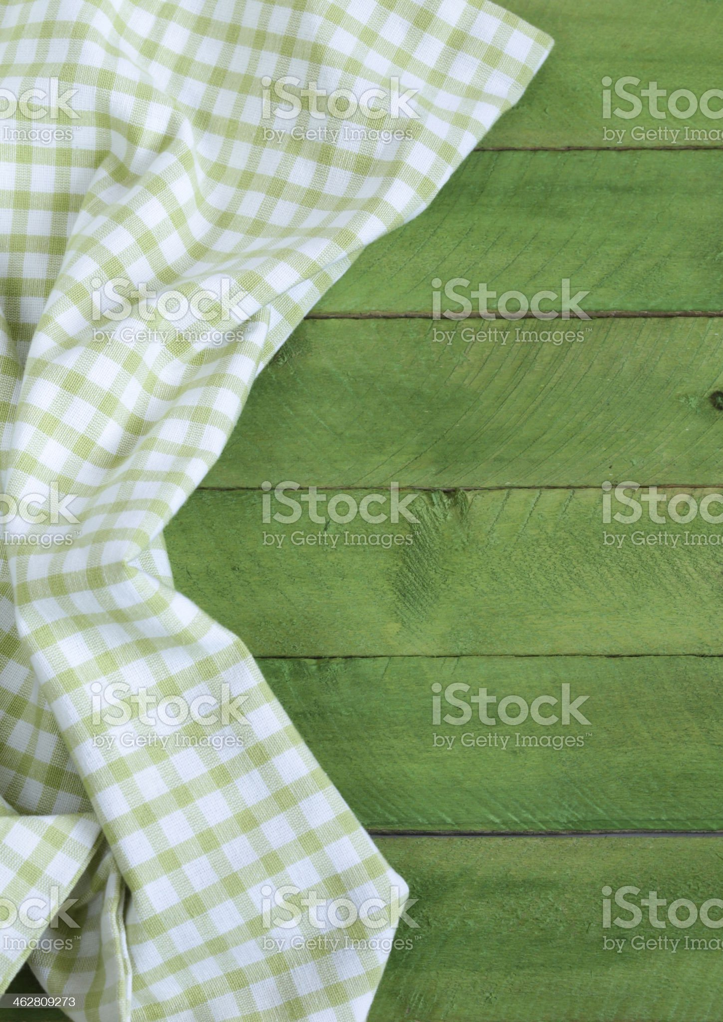 Wooden background with green checkered kitchen towel royalty-free stock photo