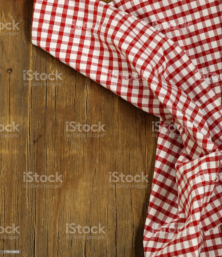 Wooden background with red checkered kitchen towel stock photo