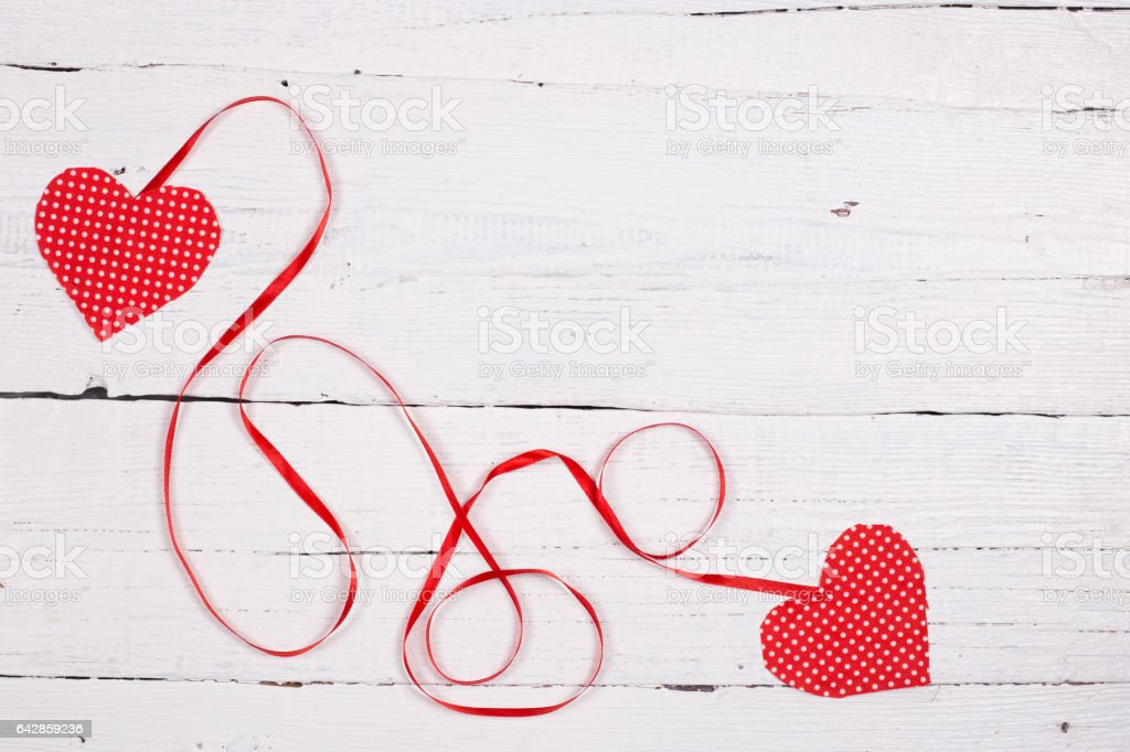 Wooden background with two red hearts stock photo