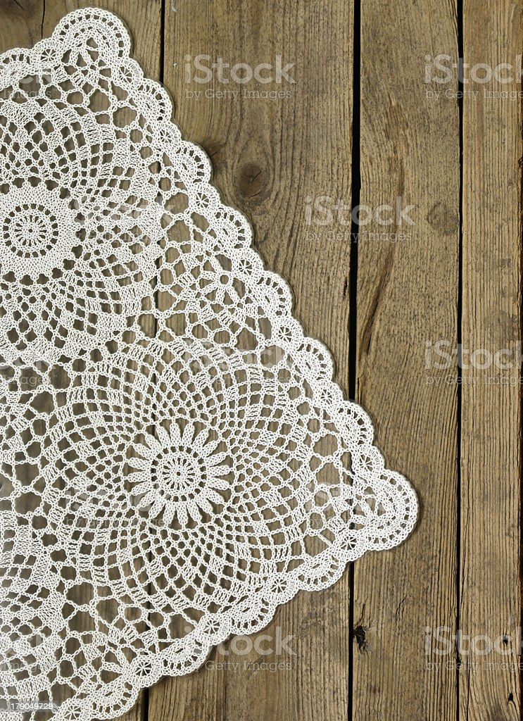 wooden background with white lace napkin royalty-free stock photo