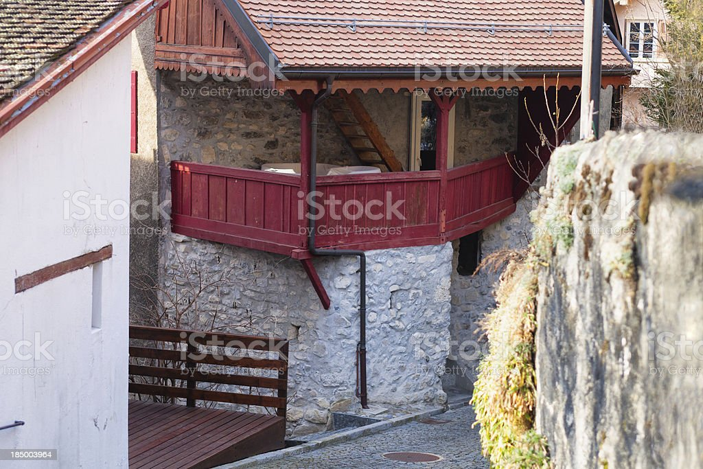 Wooden Balcony on a House in Veytaux stock photo