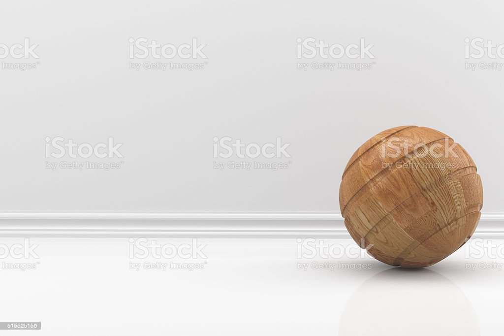wooden ball in a white room stock photo