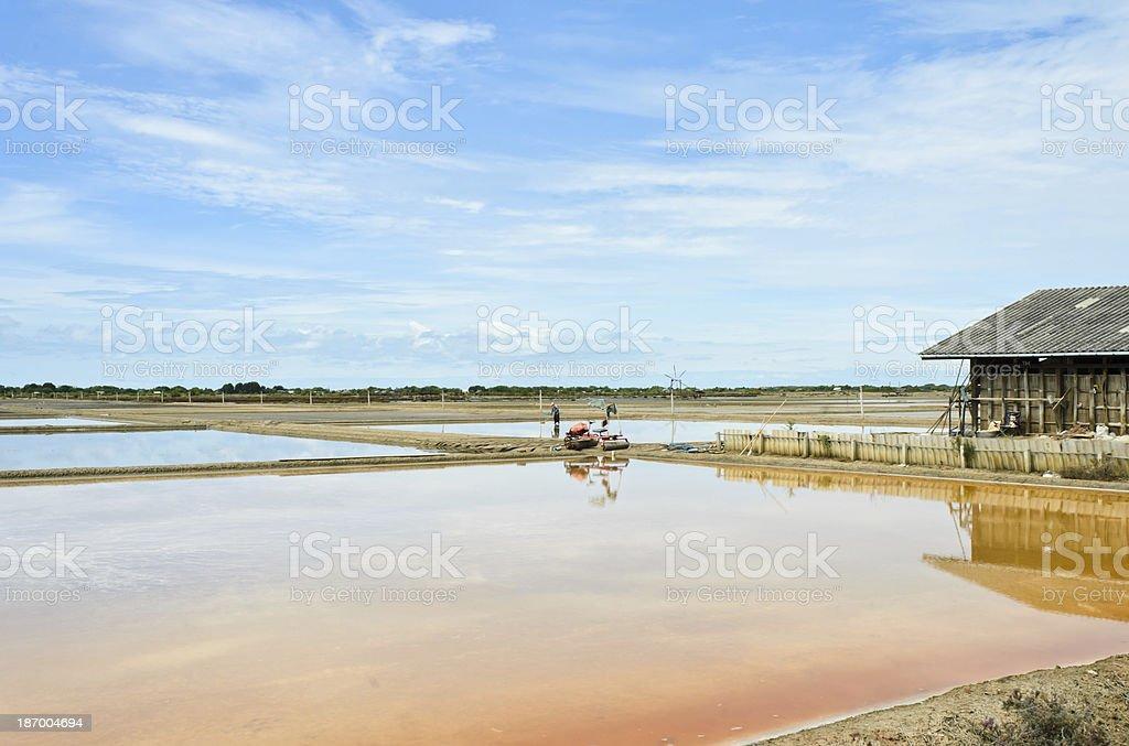 Wooden barn in salt ponds stock photo