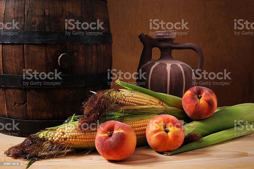 Wooden barrel and corn stock photo