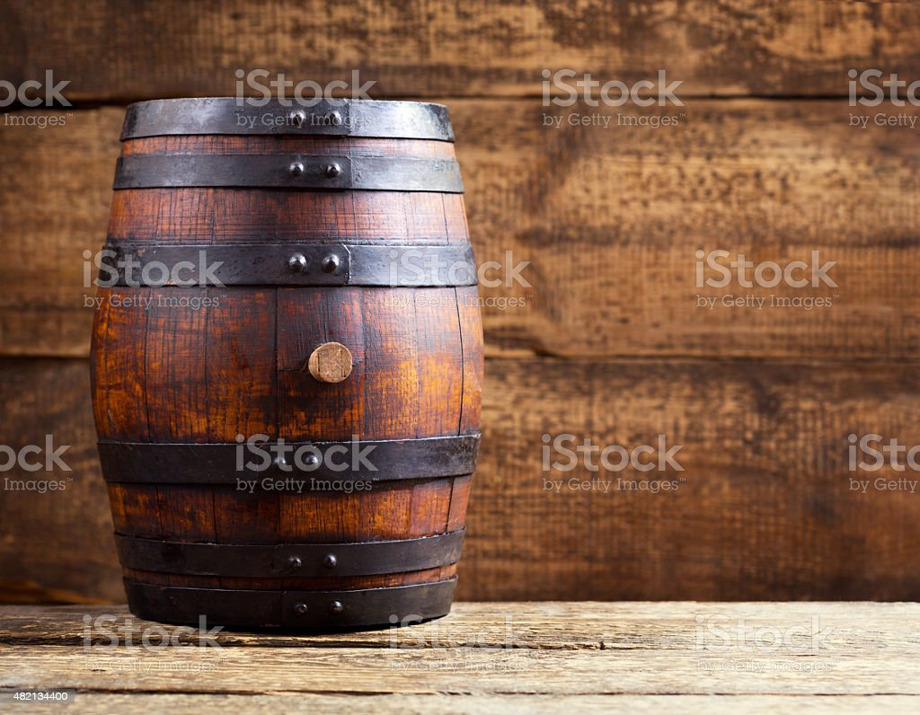 wooden barrel on rustic wooden background stock photo