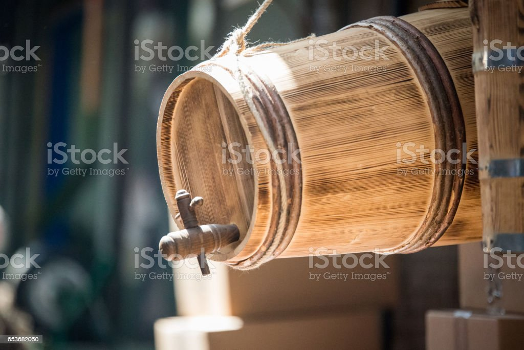 A wooden barrel with wood barrel spigot hanging in front of an old traditional store near Grand Bazaar, Istanbul. stock photo