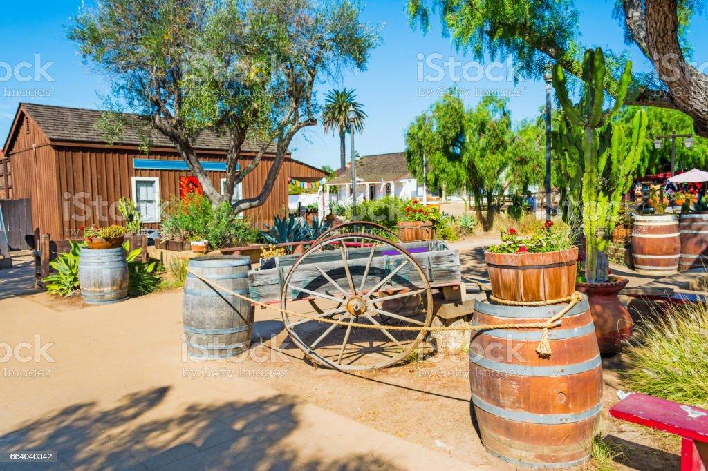 Wooden barrels and cart stock photo