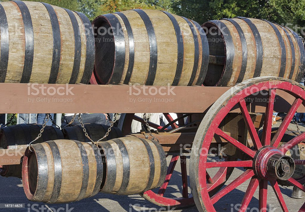 Wooden barrels at an  farm wagon in a countryside parade royalty-free stock photo