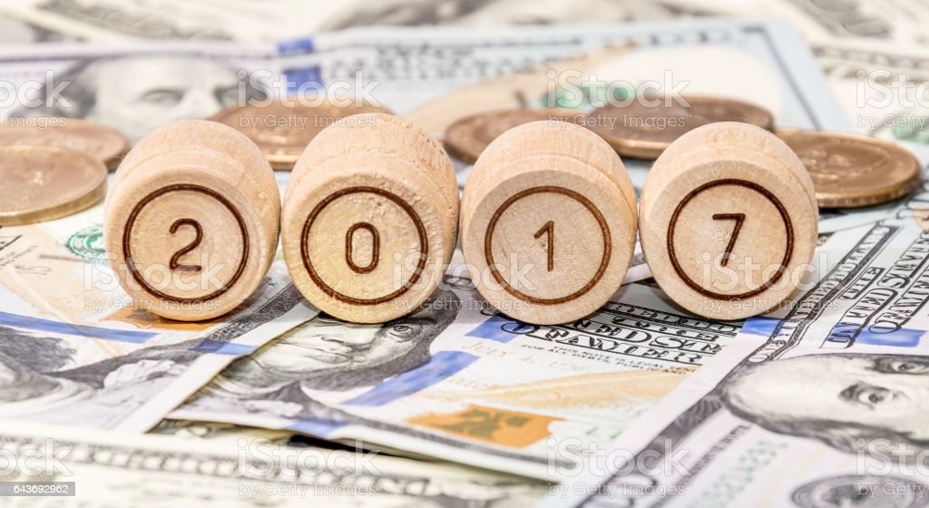 Wooden barrels with numbers '2, 0, 1, 7' on dollars. stock photo