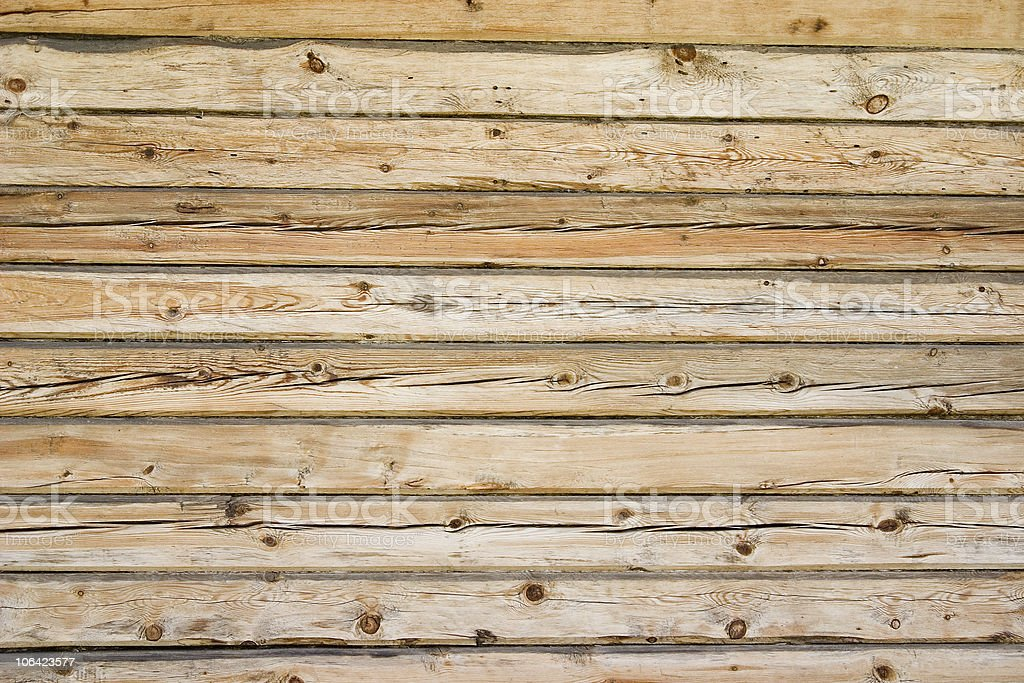 Wooden bars in the wall. royalty-free stock photo