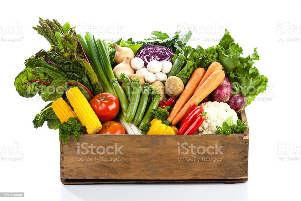 Wooden basket filled with different types of vegetables stock photo
