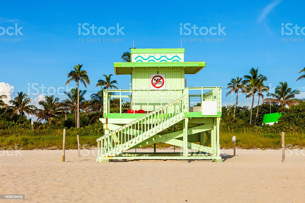 wooden bay watch hut at the beach stock photo