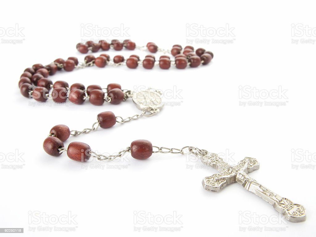 Wooden bead rosary on white background stock photo