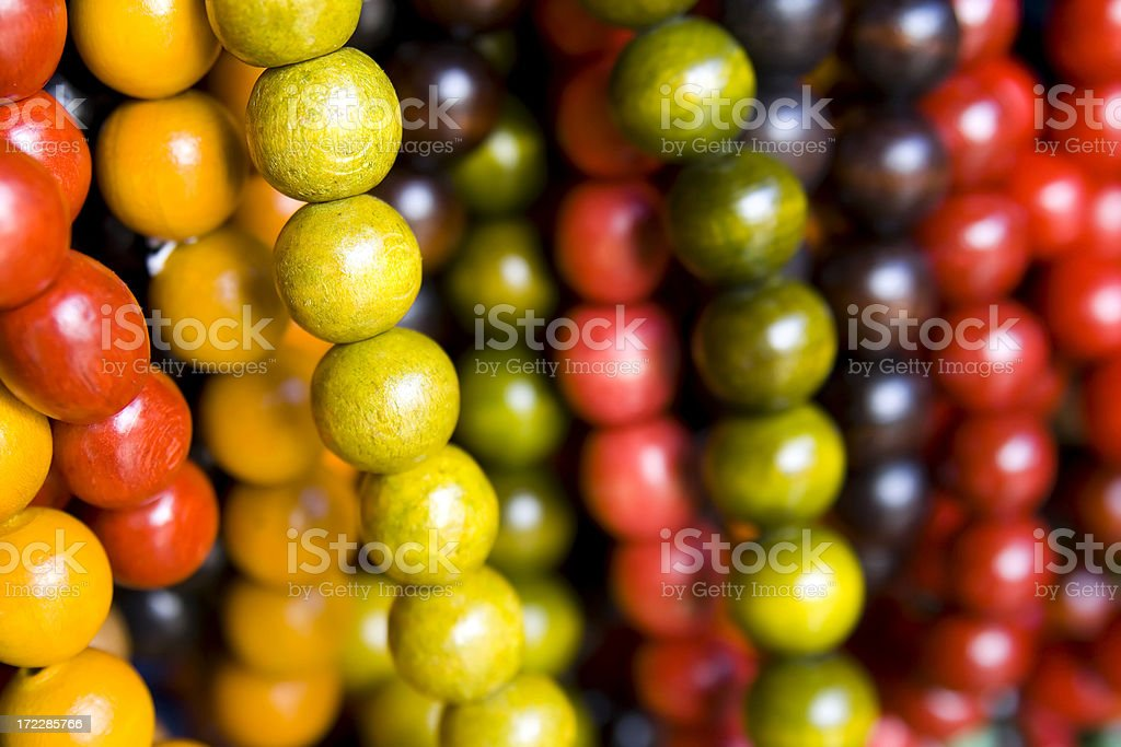 wooden beads in gold autumn colors royalty-free stock photo