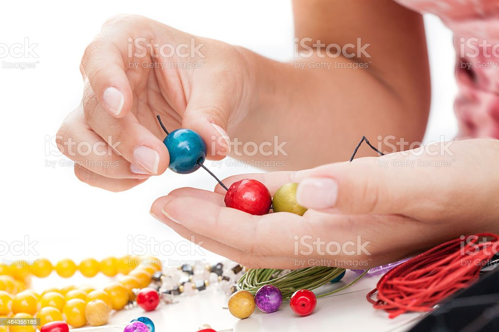 Wooden beads springing stock photo
