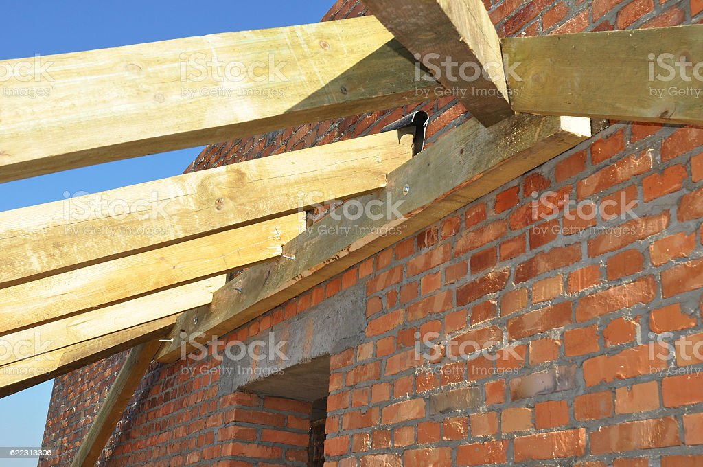 Wooden beams at construction the roof truss system stock photo
