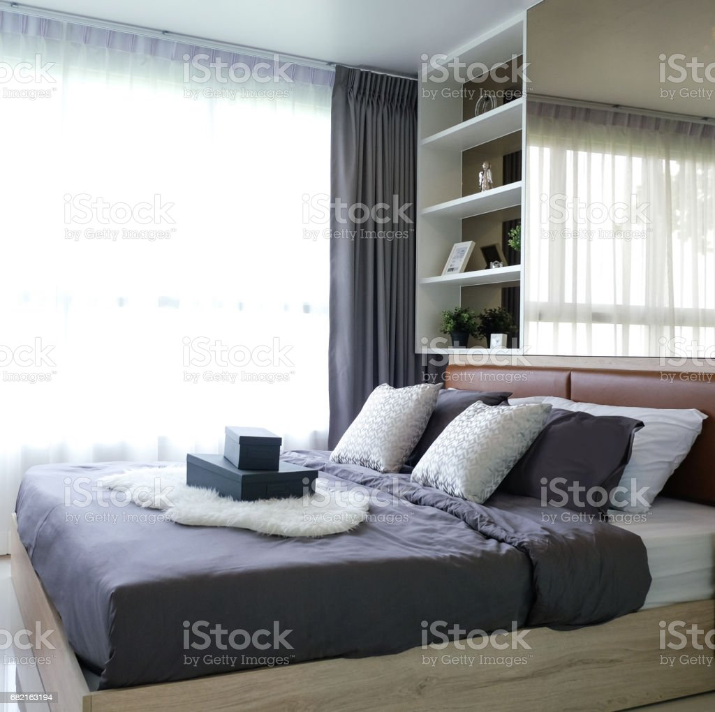 Wooden bed in room. stock photo
