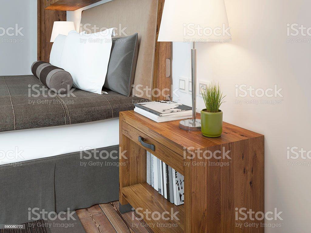 Wooden bedside table with a niche for the decor. stock photo