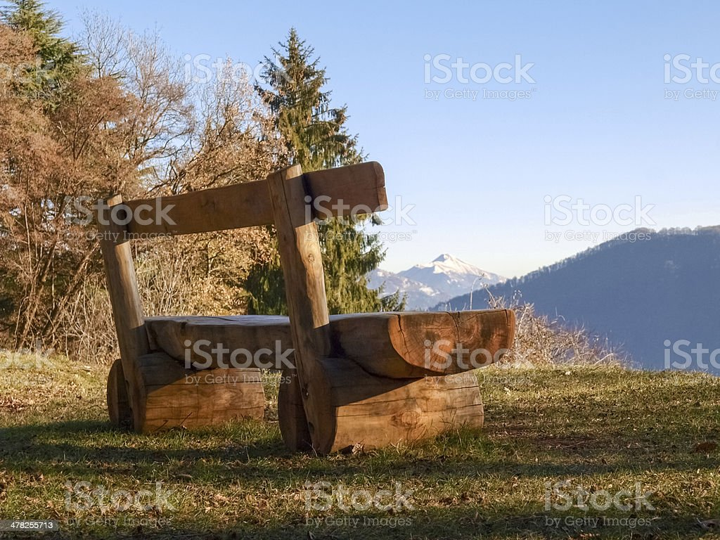 Wooden bench and mountain views stock photo