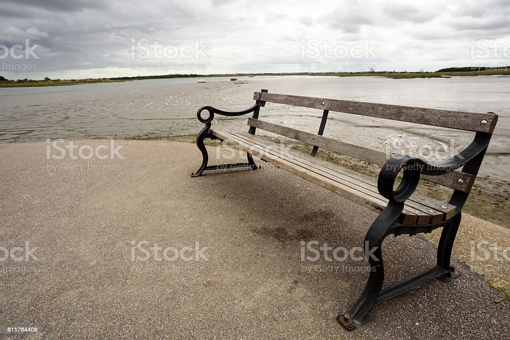 Wooden Bench and River Background stock photo