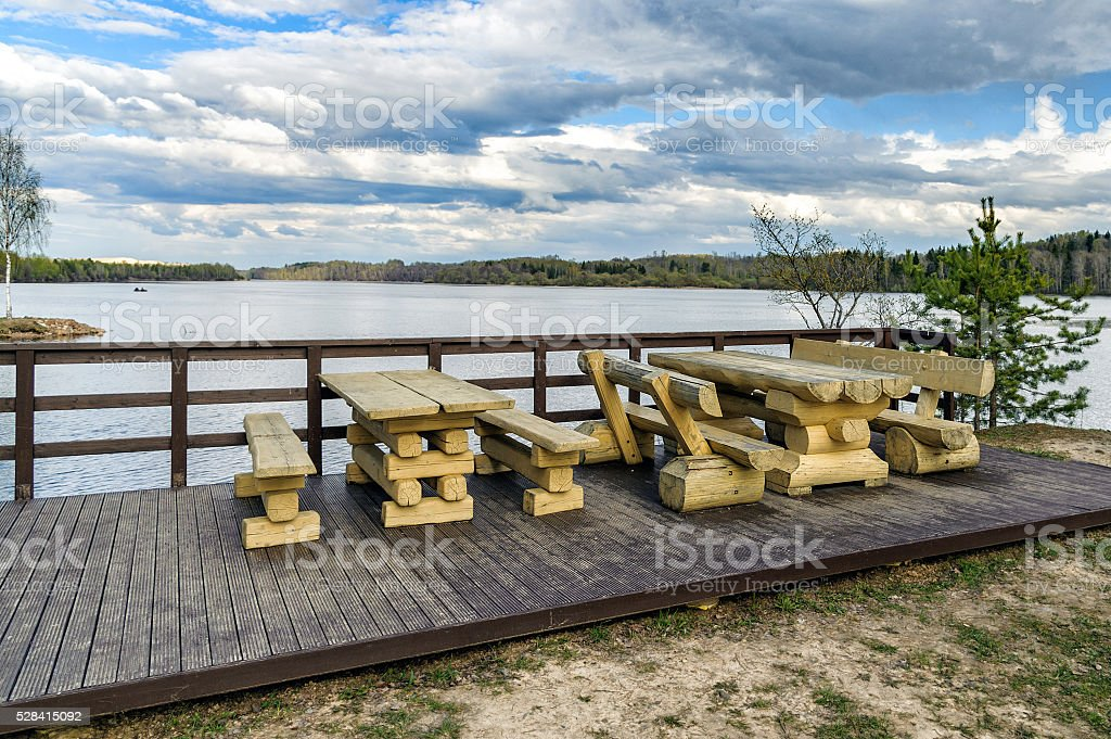 Wooden bench and table made of tree trunks stock photo