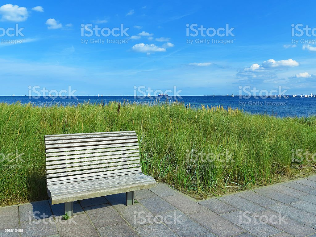 wooden bench and view to the sea stock photo