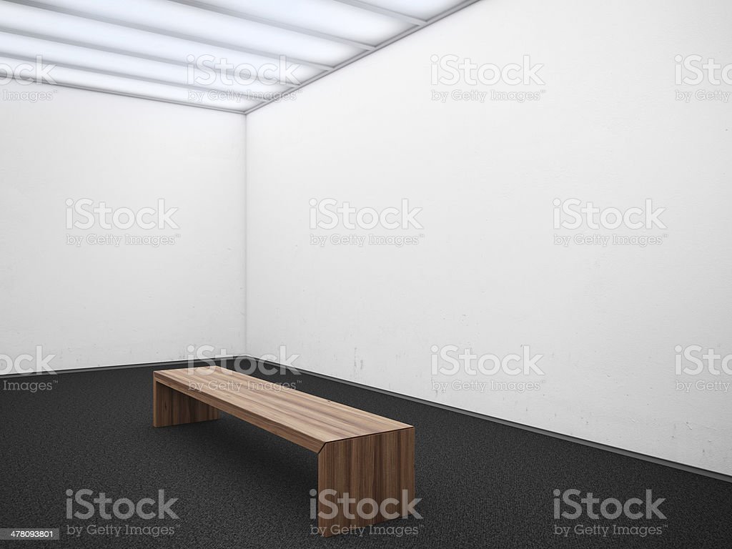 wooden bench at an empty gallery royalty-free stock photo