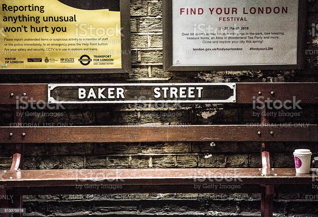 Wooden bench at Baker Street Station stock photo